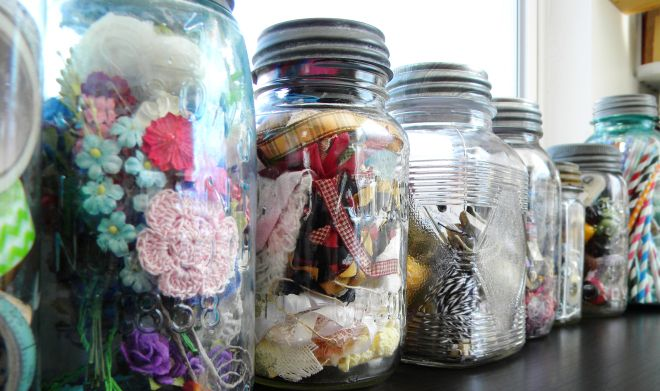 Store ribbon, flowers, twine, straws and other paper crafting supplies in vintage Mason jars. They make great scrapbook organization.