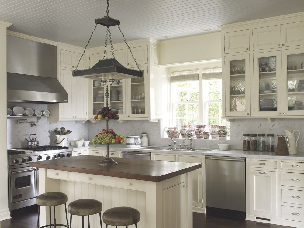 The light-filled Bayside Colonial Kitchen is detailed ...