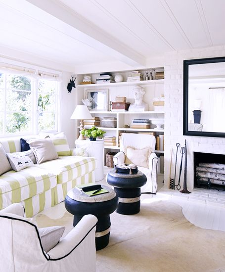 Mantle Makeover: How To Give Your Hearth a New Look // mantle decorating ideas, striped sofa, white brick fireplace,