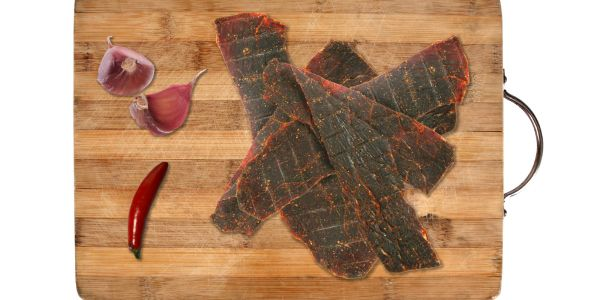 Moist and tender premium lean beef seasoned with our finest herbs and spices.  We kick it way up by adding our sizzling Three Pepper Spice Blend.   Marinated overnight and then cooked over low heat until perfectly done, our Spicy Beef Jerky is a mouthful of heat and flavors.