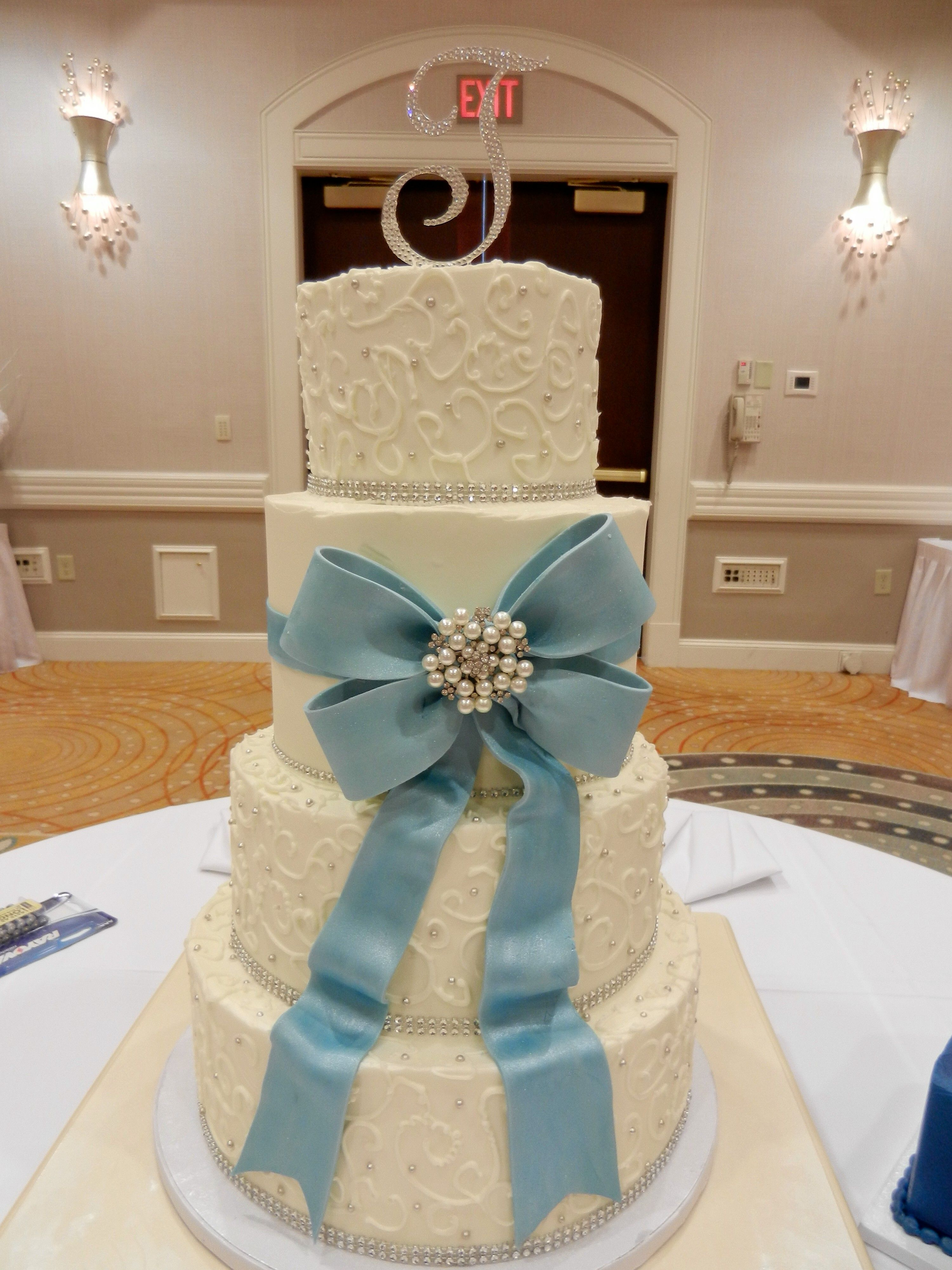 wedding cake with bow and broach wwwcheesecakeetcbiz wedding cakes charlotte nc