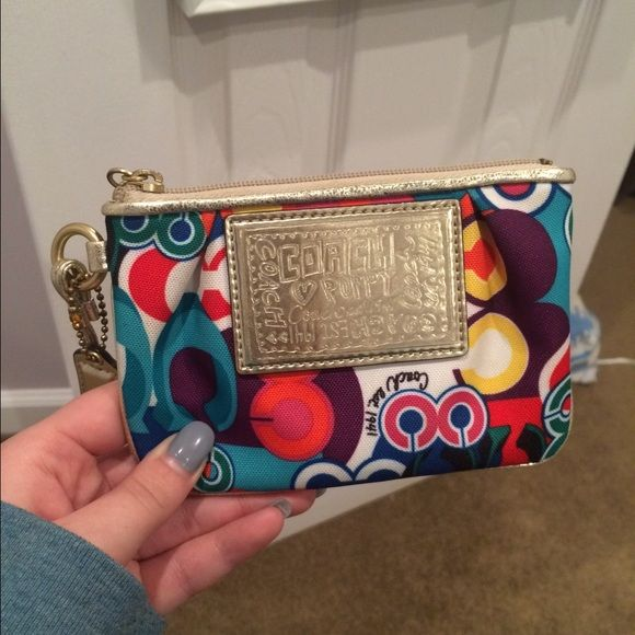 Coach Poppy Wristlet Colorful coach design with metallic gold accents. Blue interior. Previously used with material in good condition- small stain on back. Coach Bags Clutches & Wristlets