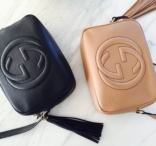 92b495e6ff5 Black leather and camel leather Gucci Soho Crossbody bags with a tassel.