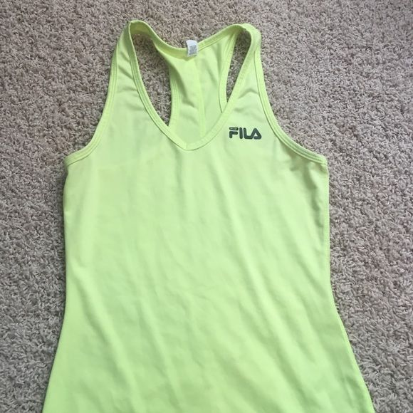 Neon yellow workout tank top Worn once. Brighter yellow then the picture shows Fila Tops Tank Tops