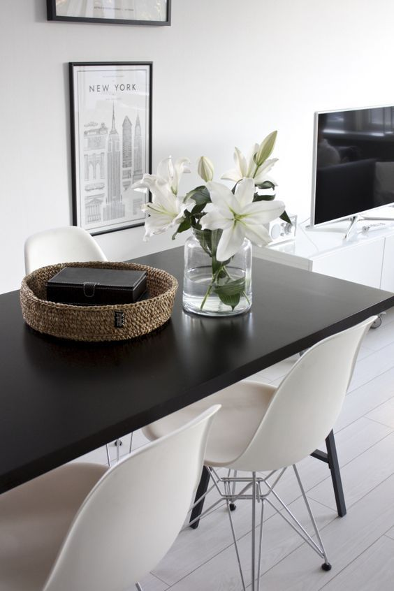 Homevialaura | kitchen | dining space | white lilies | Eames DSR chair | Tikau basket