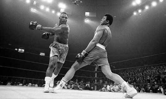 "Muhammad Ali dodges a punch from Joe Frazier at the ""Fight of the Century""March 8, 1971 [530x317] - Imgur"