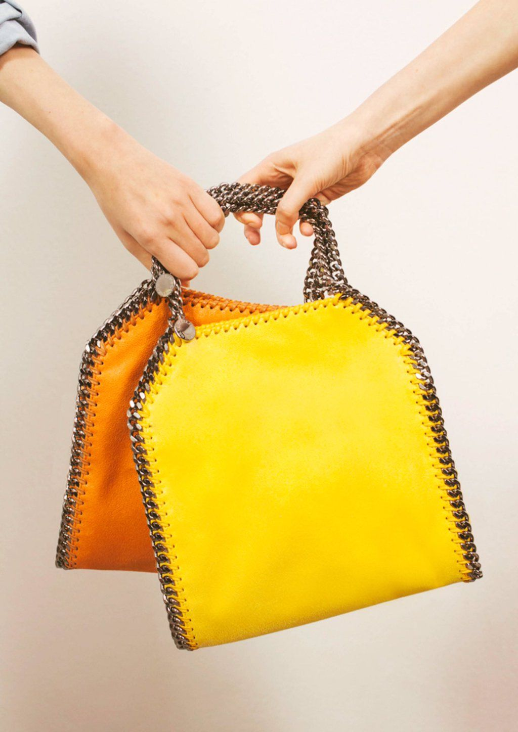 Double up on the Rainbow  POPfalabella mini-tote. Shop Orange for  Playfulness and Golden Syrup for Joy at  StellaMcCartney.com 314d9d6400a7b