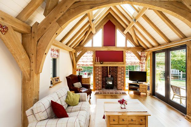 Large timbered sitting room with doors to garden
