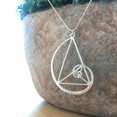 This geometric necklace is a combination of a golden triangle and a golden spiral - golden ratio. It's large and impressive and yet very delicate, and for sure