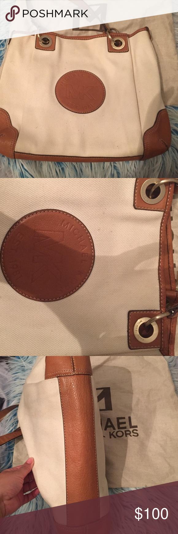 Michael Kors handbag pre owned Tan leather with beige cloth Michael Kors handbag previously worn great condition! MICHAEL Michael Kors Bags Hobos