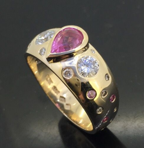 Kathleen Kumskov would like to brighten your day with this fabulous pink sapphire, diamond and yellow gold remodelled dress ring. Peter Kumskov designed in communication with the client. Custom hand made dress ring created from worn out, or unworn Jewellery at 'My Own Jeweller Direct' in Runcorn near Sunnybank in Brisbane