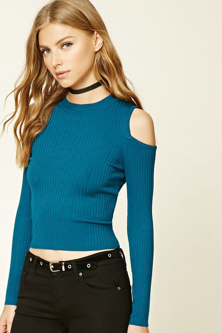 A ribbed knit top featuring an open-shoulder design, a mock neck, and