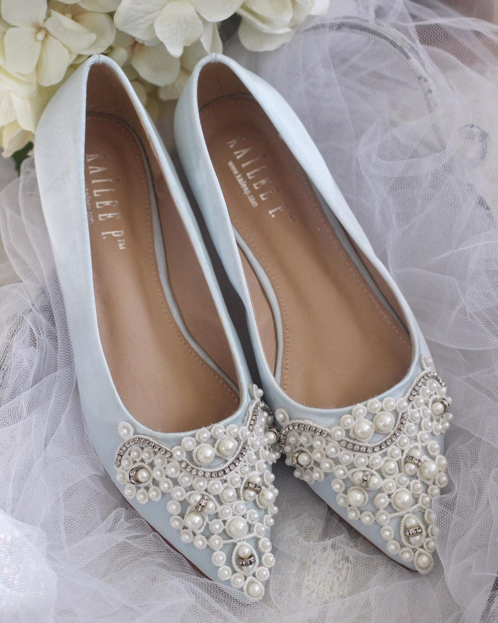 Light blue satin pointy toe satin flats with oversized