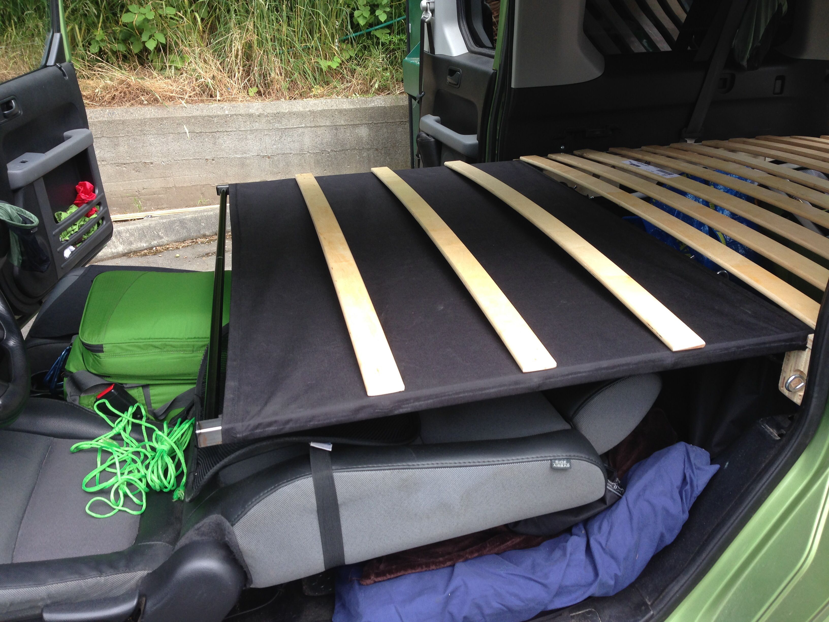 Custom folding frame fit a fullsized bed in a honda element with