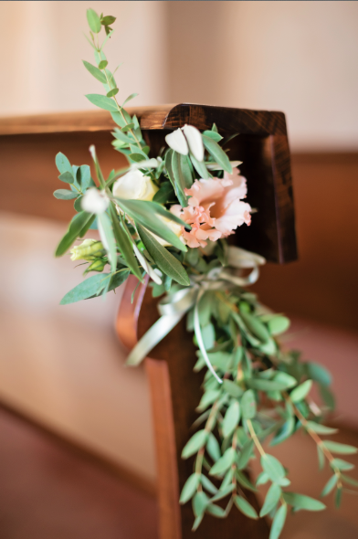 Flower On Pew Olive Branch And Light Apricot Roses Event Design By Weddings International Floral Design By Weddings International