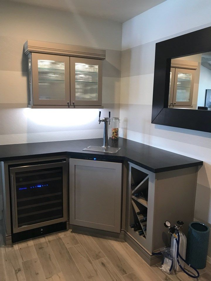 this dry bar build out with a kegerator features wellborn