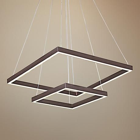 The understated framing of this modern two-tier LED pendant bolsters a sense of openness and warmth.
