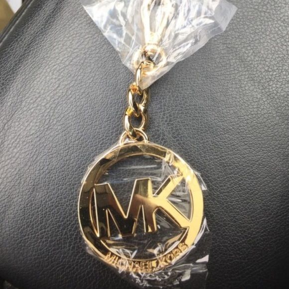 Gold Michael Kors Keychain brand new Never used have had this for a while it's still in perfect condition in plastic comes with the original gift box and everything ready to ship !  perfect for your keys or a statement piece on your bag MICHAEL Michael Kors Accessories