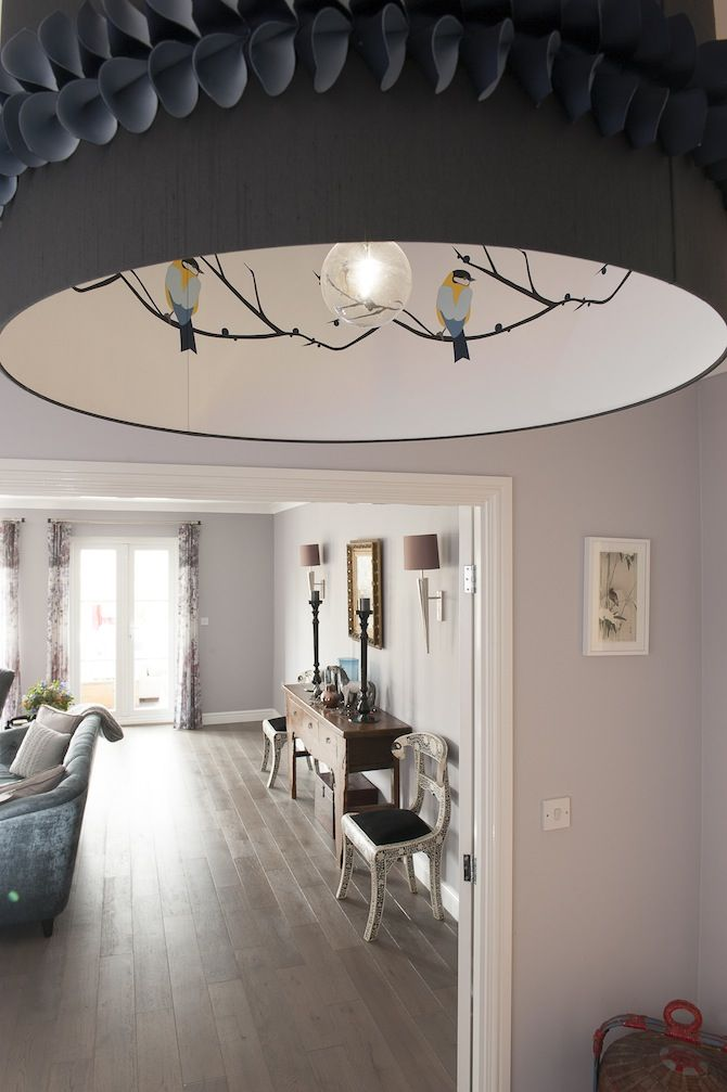 A smart act hidden birds in an over sized lampshade designed by smartstyle interiors