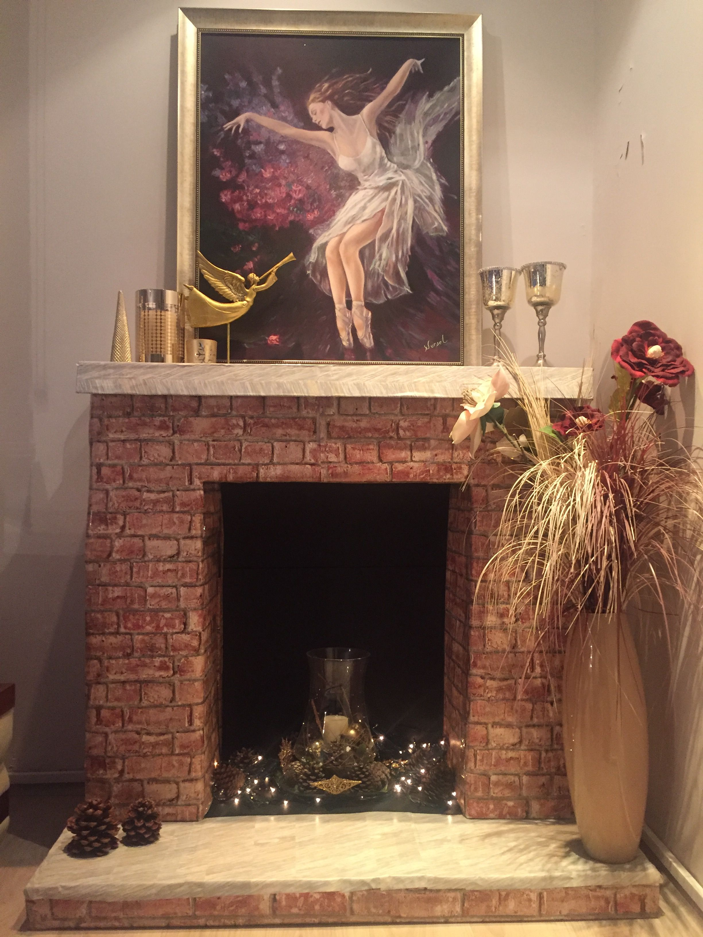DIY Faux Fireplace from cardboard with stone looking