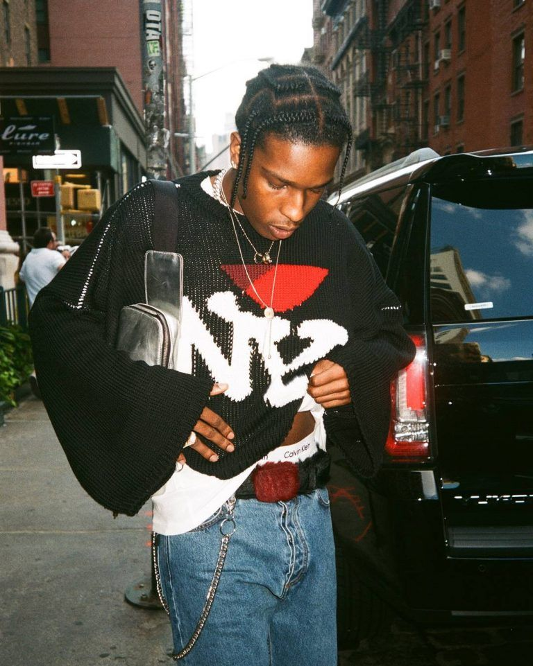 ASAP Rocky Seen Wearing Raf Simons Sweater, Prada Belt