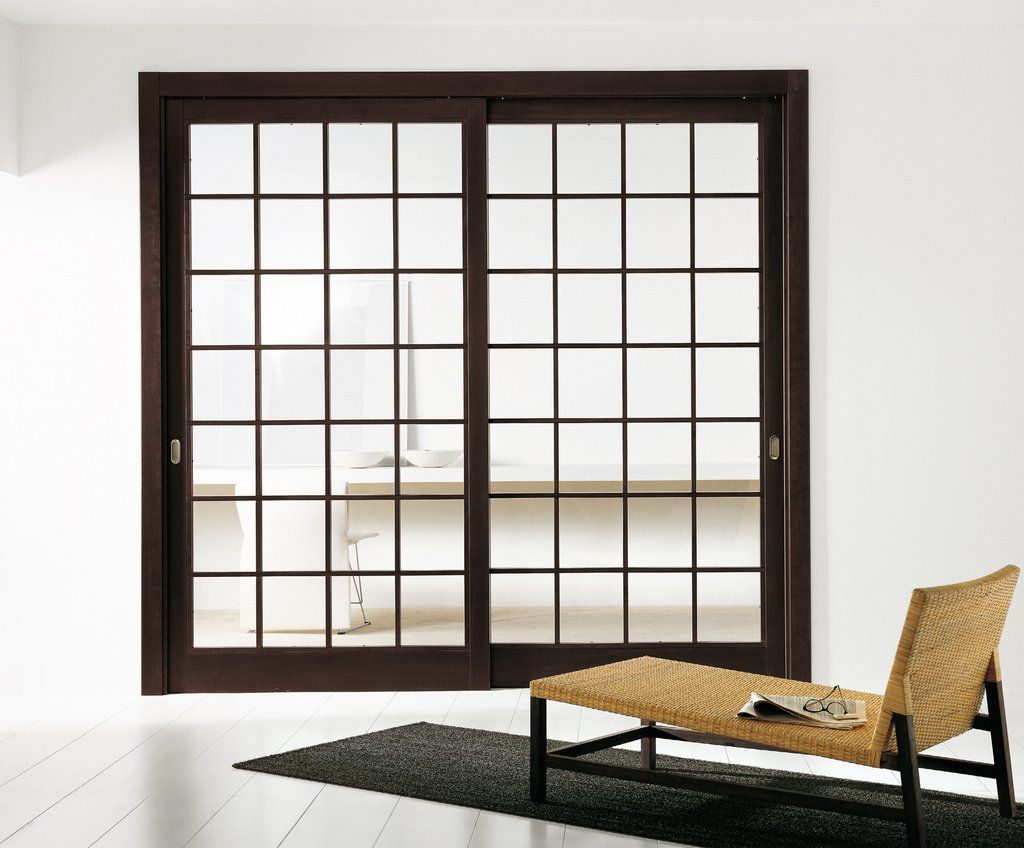 modern interior sliding door featuring a transparent glass panel