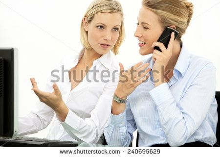 Female business partners working together - Pretty blond hair colleagues at workplace - stock photo