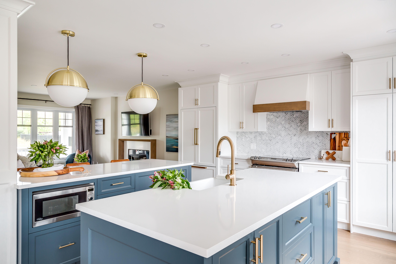 Our Bellay Street Project White Kitchen Cabinets Brass Hardware Navy Kitchen And White Quartz Countertop Home Kitchens Kitchen Design Blue Kitchen Island