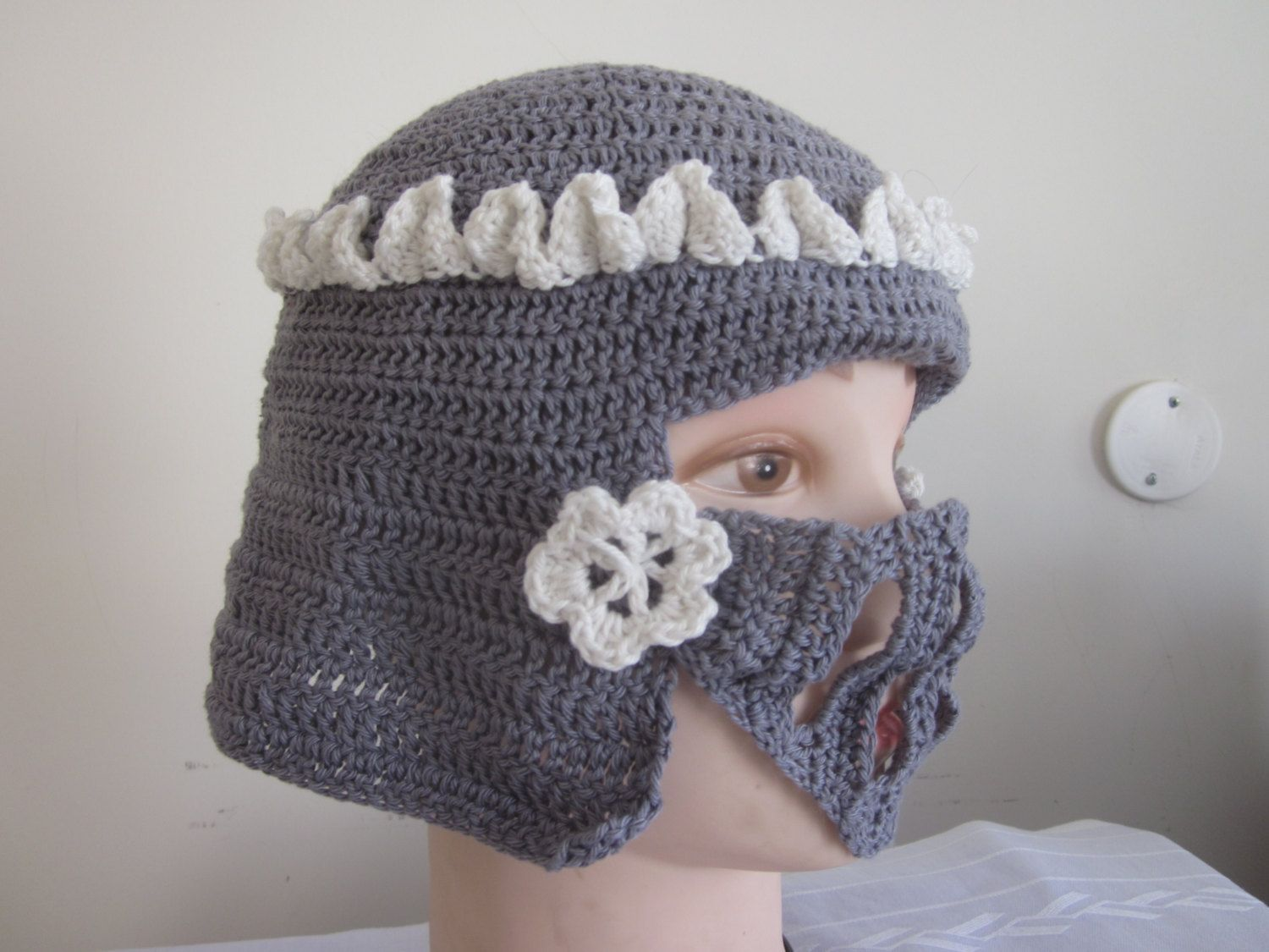Knight helmet, crown and flowers decoration, a geeky hat shaped like ...