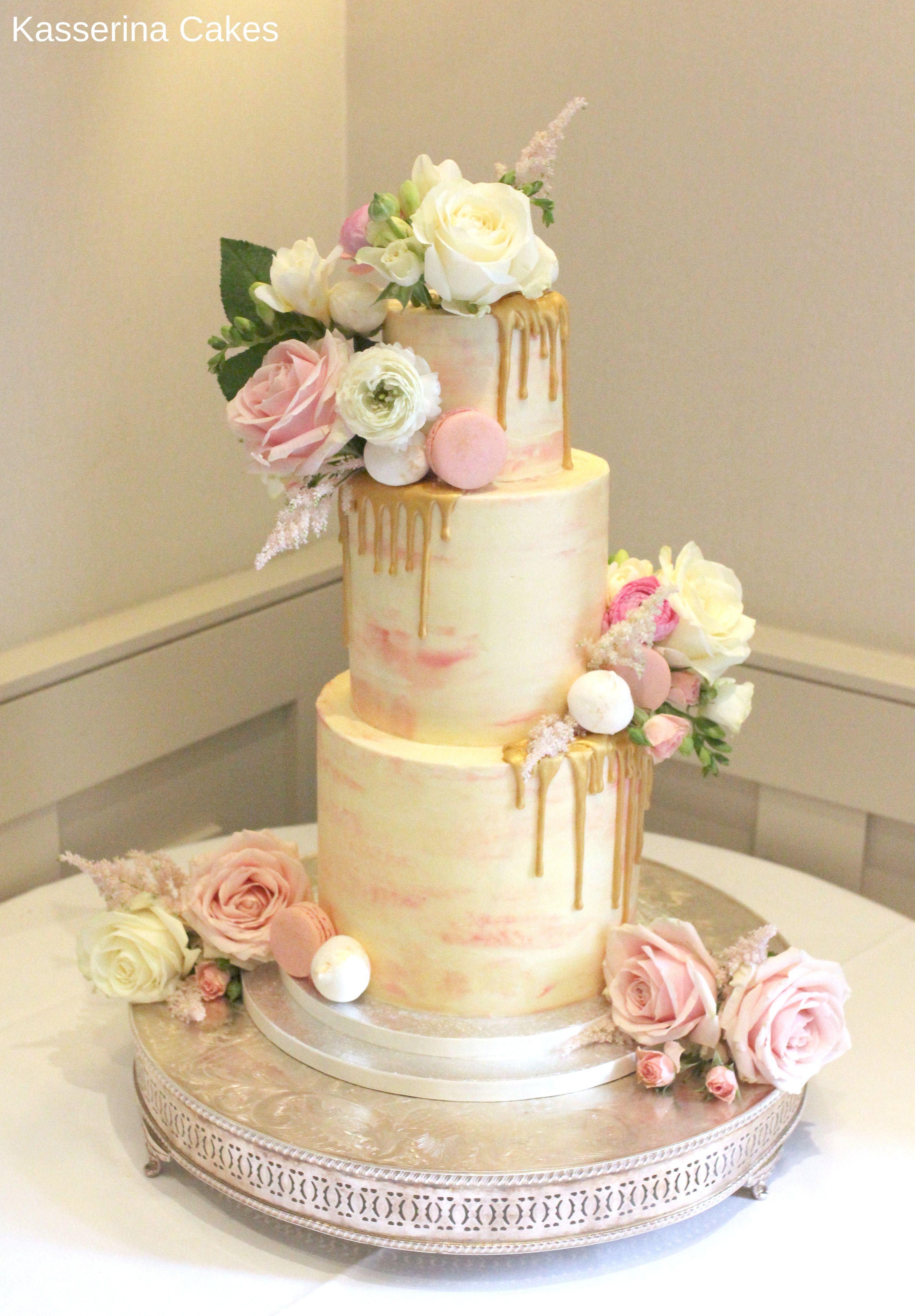 Watercolour effect buttercream wedding cake with fresh flowers ...