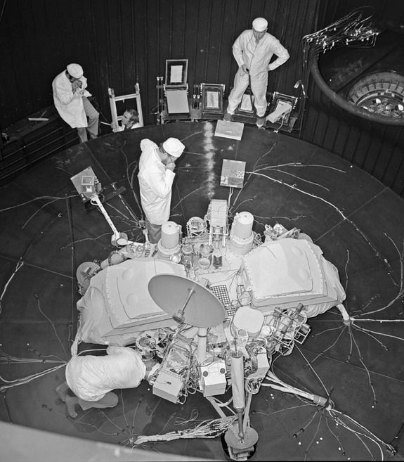 Viking Mars lander undergoes checkout and testing by Martin Marietta engineers.