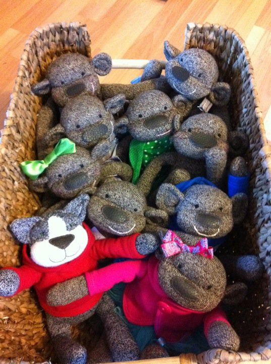 A basket full of Monkeys - What's wrong with this - where's the barrel? So cute. http://www.facebook.com/hey.monkey.sock.monkeys