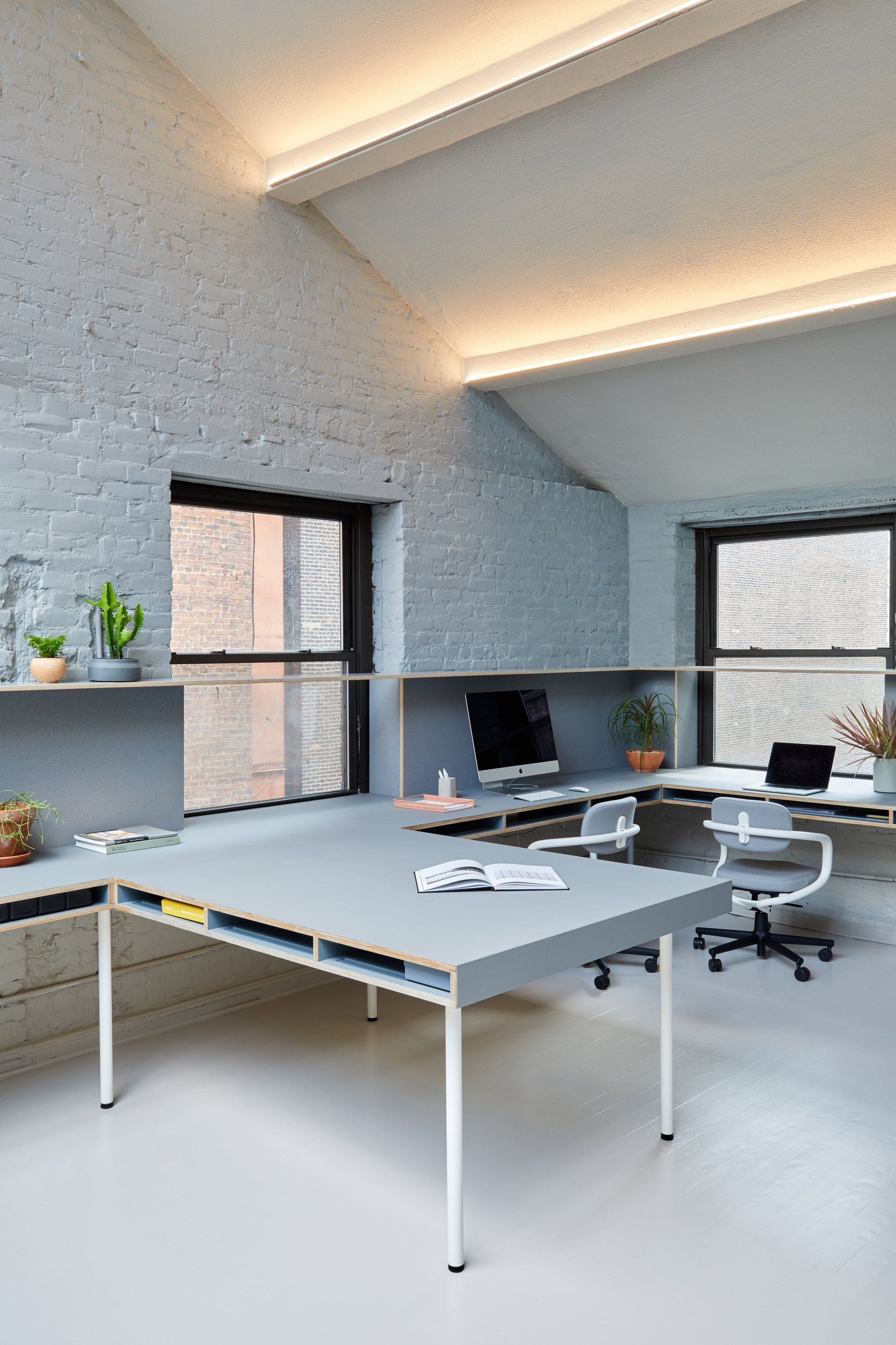 GRT Architects creates New York office with millennial-pink kitchen ...