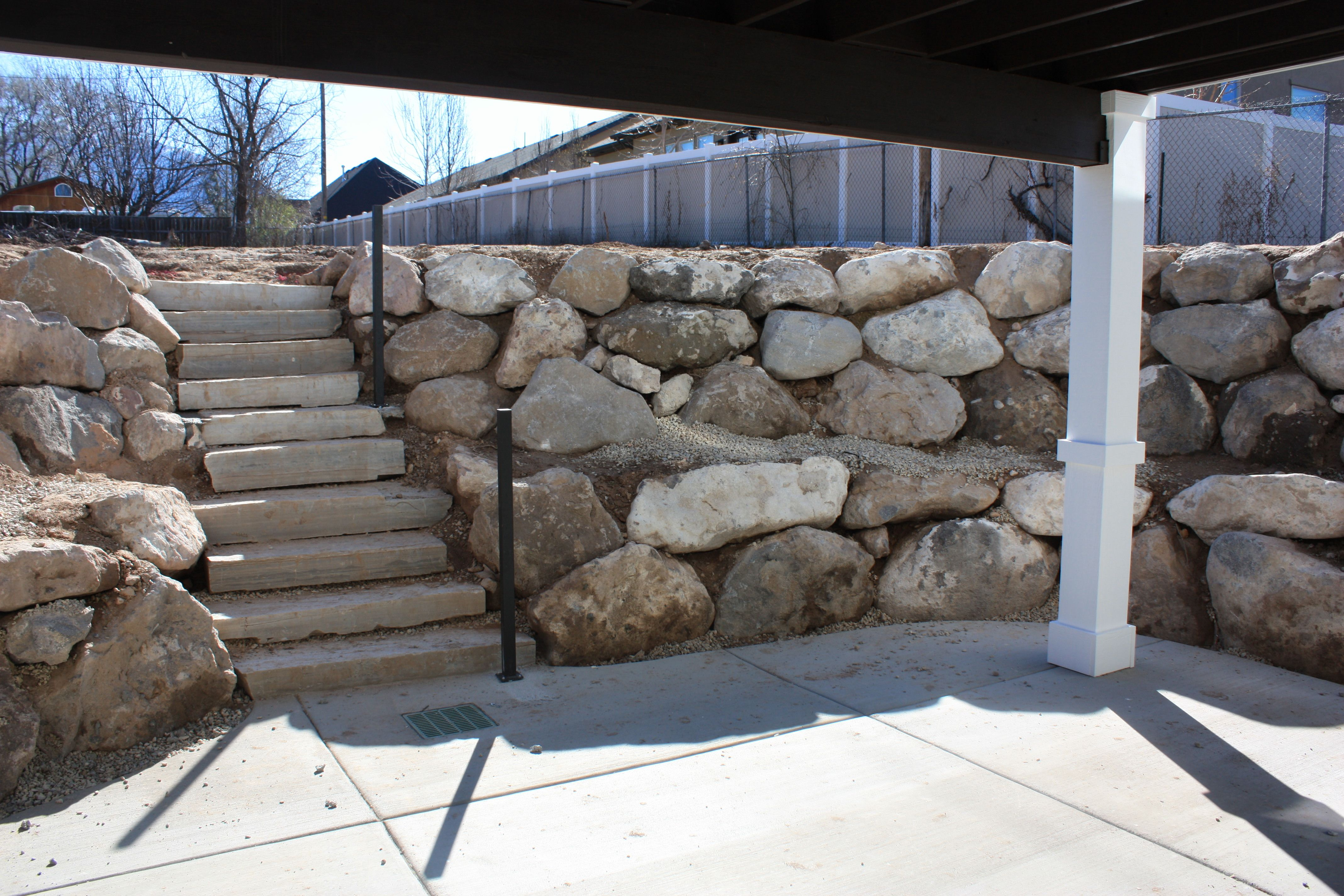 Walk Out Basement Retaining Wall And Stone Steps.