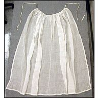 "Woman's apron, semi-sheer white linen  1780-1800  Origin: America, Pennsylvania, Philadelphia  OL: 42 1/4"" OW at hem: 58 1/4"" Side Length: 42"" Center Front Length: 37 1/2"" Hem Depth: 12 cm (approx. 1/2"") Gathered to 17"" at waistband Waistband: 5/16"" wide and 66 1/2"" long  Linen, plain-woven  Gift of Titi Halle.    Acc. No. 2004-17, Colonial Williamsburg"