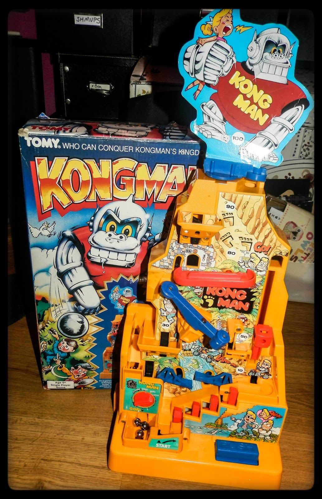 A Kong Man toy with its original 1980s packaging
