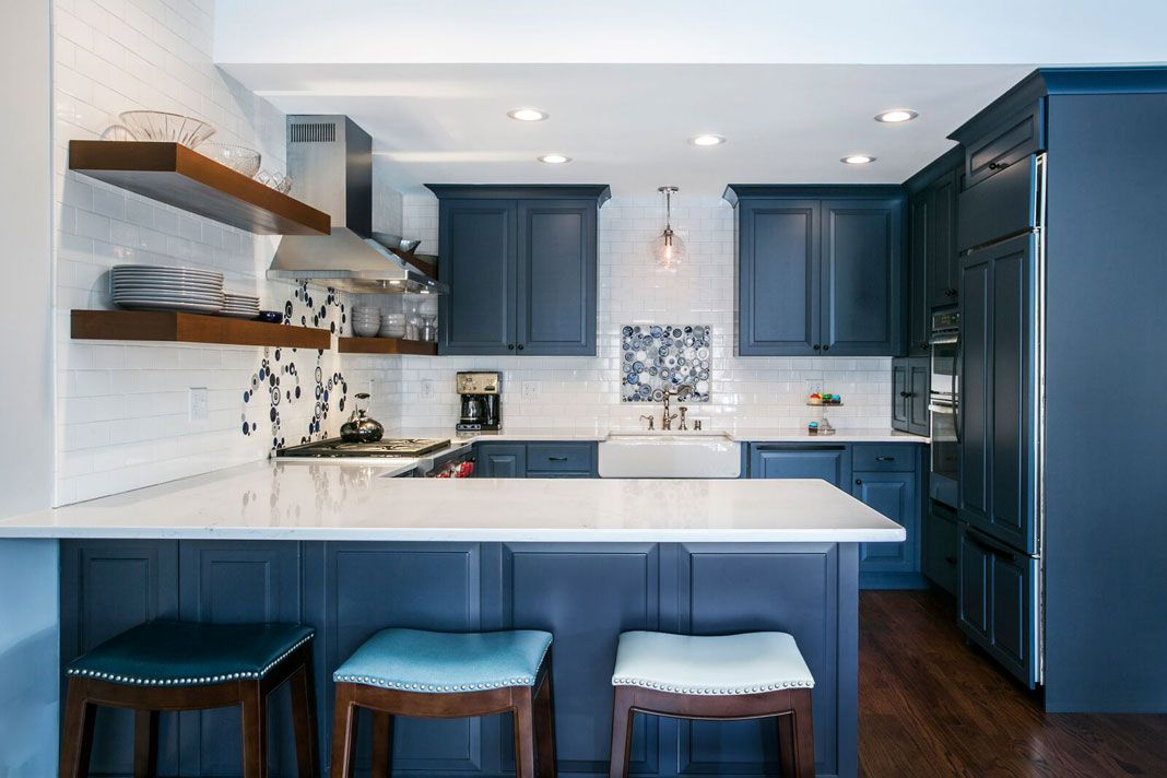 A Blue Kitchen With White Walls Floating Shelves And Dark Wood Flooring Blue Kitchen Walls Kitchen Inspiration Design Wood Floor Kitchen