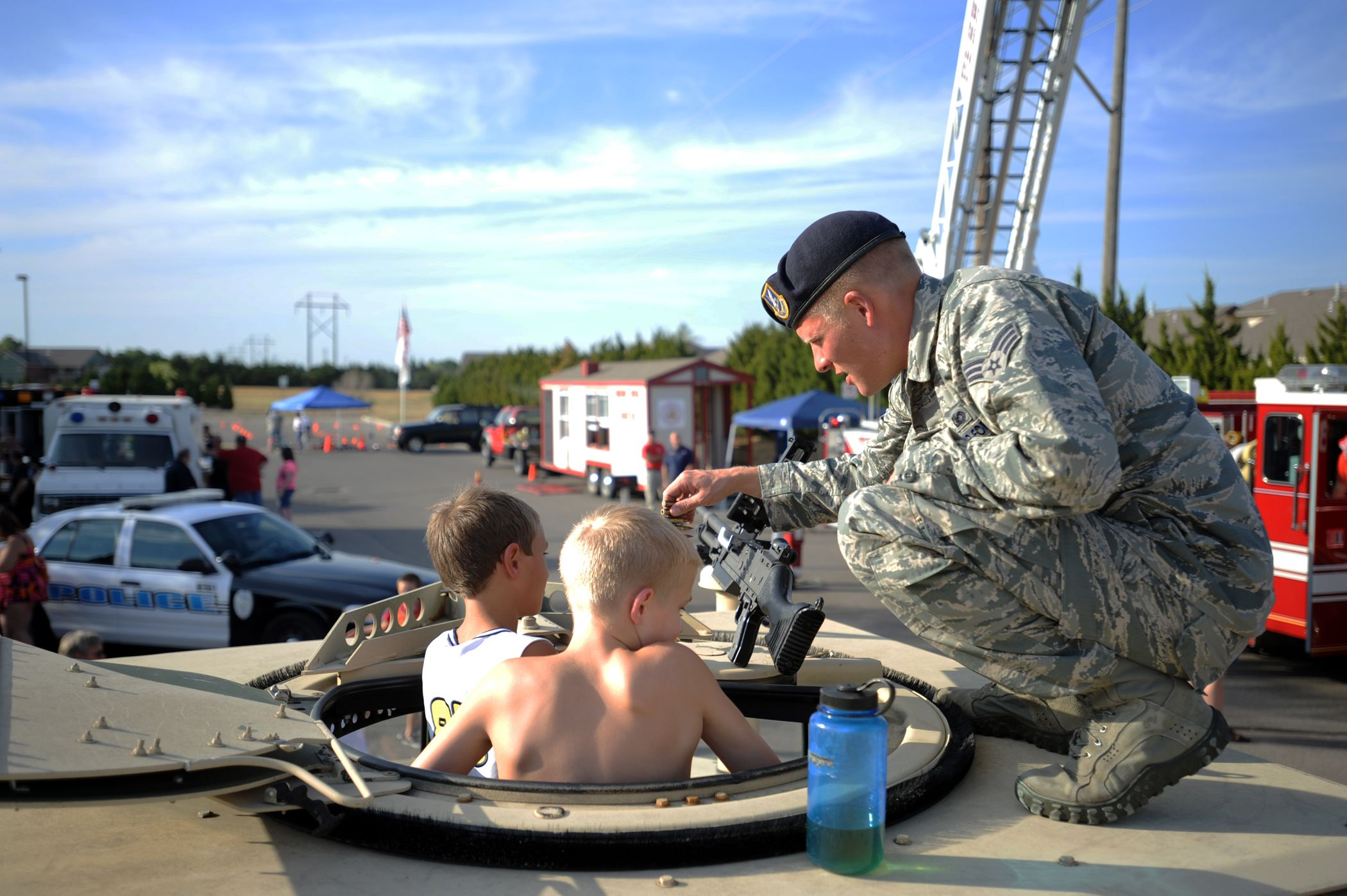 Senior Airman Erik Ippel helps children as they explore a