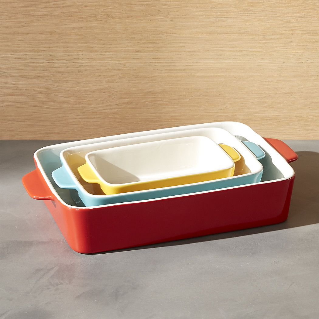 Free Shipping Shop Potluck Baking Dishes Set Of 3 Our Popular Stoneware Bakers Shine In Primary Colors Of R Baked Dishes Casserole Dish Set Crate And Barrel