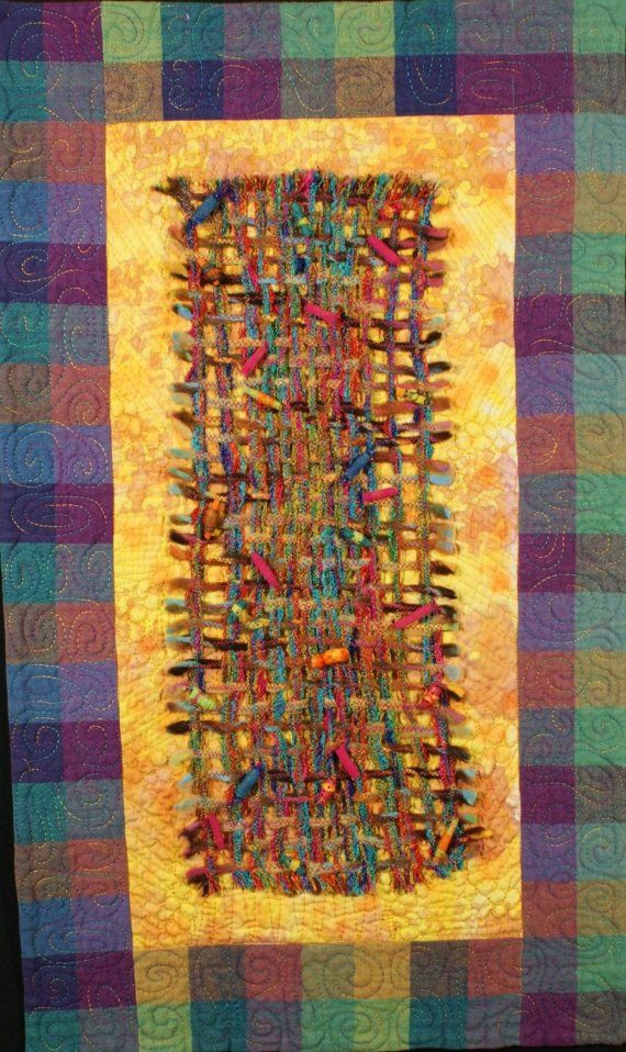 Hey, I found this really awesome Etsy listing at http://www.etsy.com/listing/49790996/handmade-art-quilt-weaving-one