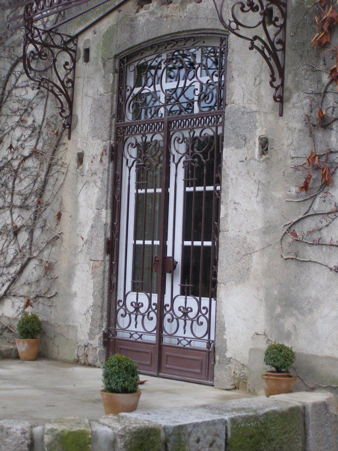 Ferronnerie d 39 art rocle portes portes fer forg puertas hierro et balcones for Porte entree fer forge villa