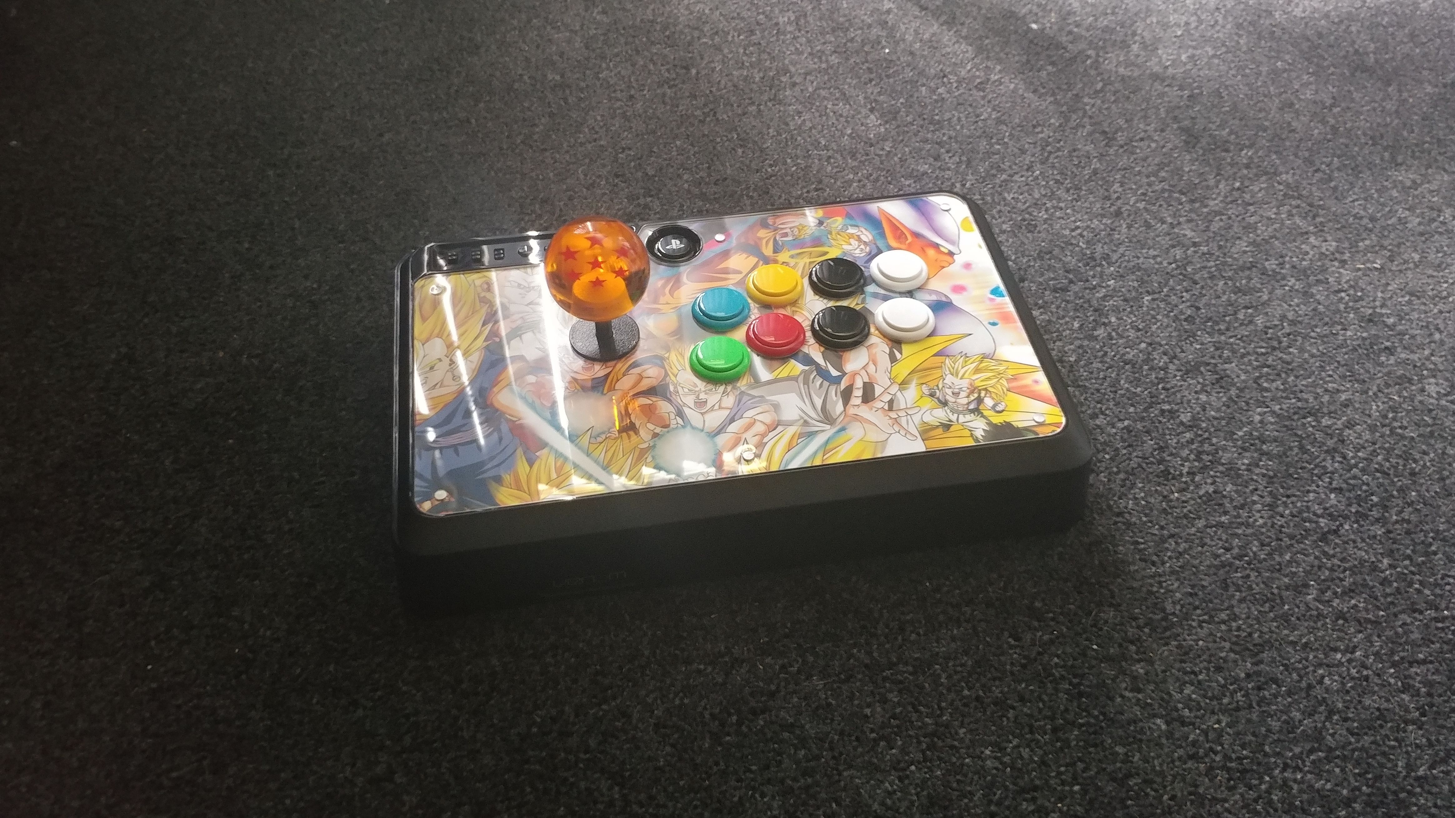 Modded my old arcade stick with sanwa parts and dragon ball theme