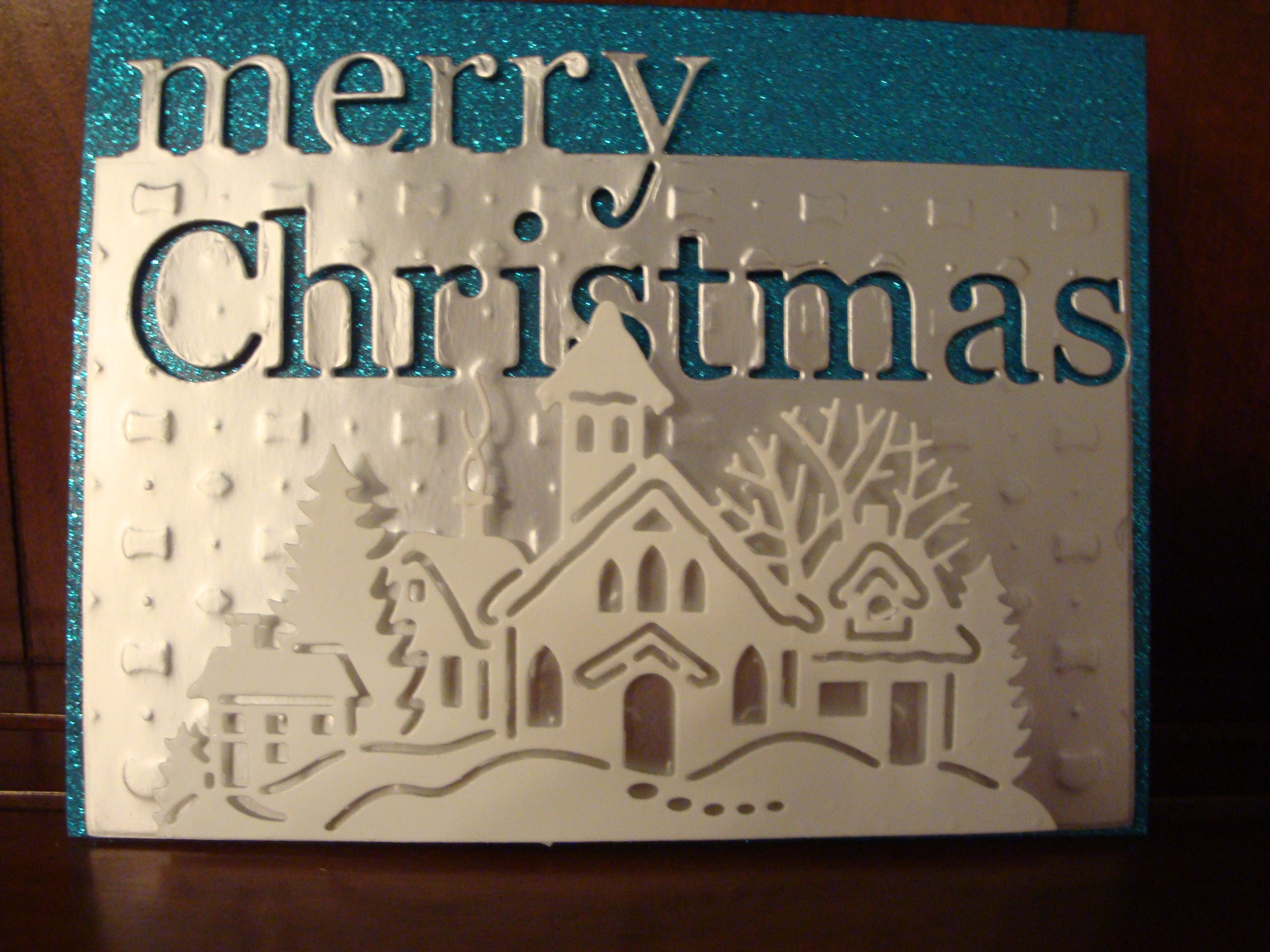 "Christmas Card 2013 - Memory Box ""Merry Christmas"", CottageCutz Village and David Tutera Embossing Plate against David Tutera Glitter cardstock"
