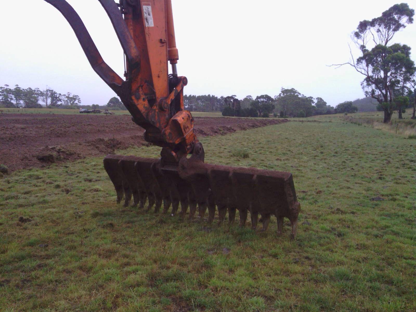 Bill King Excavations,Tasmania,stick rake 3 75 meters wide