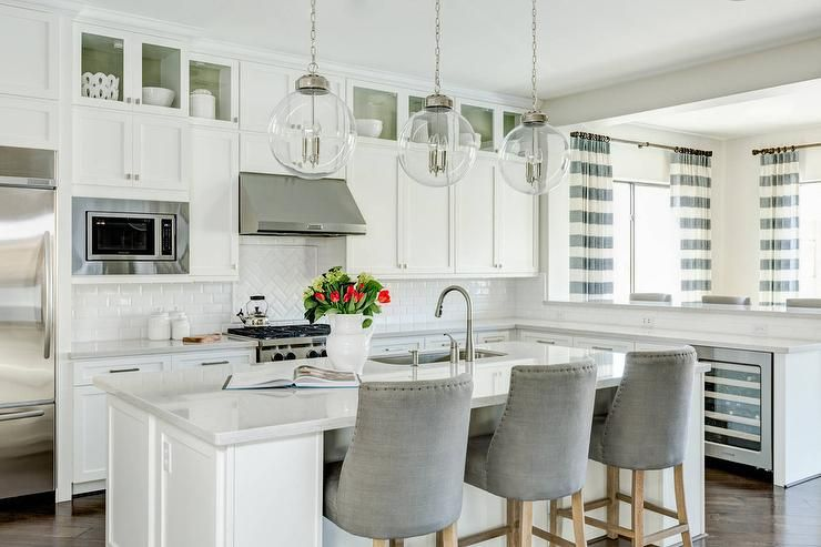 White Kitchen With Gray Velvet Counter Stools And White Beveled