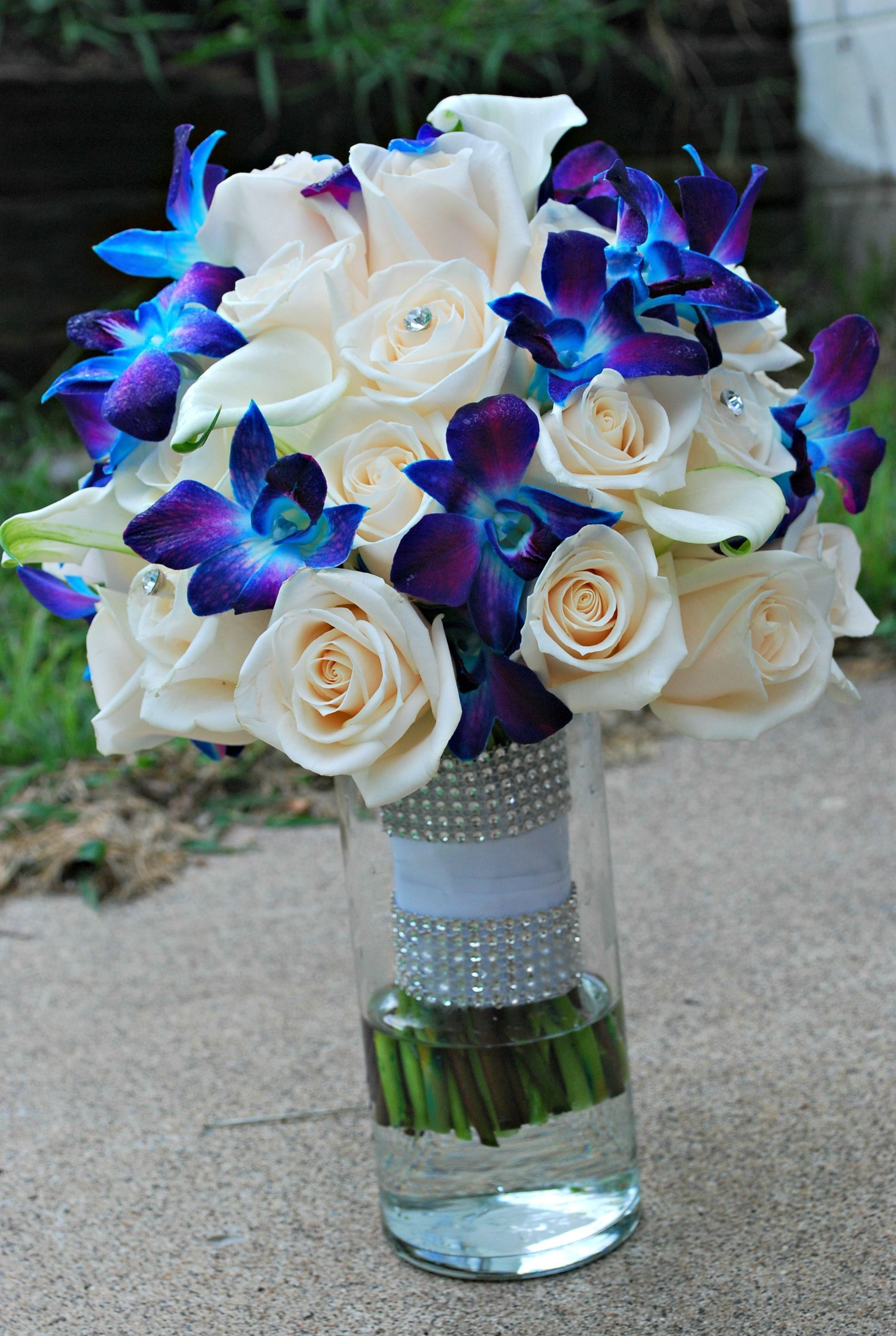 Blue Orchid wedding bouquet. Blue and purple orchids. Ivory roses ...