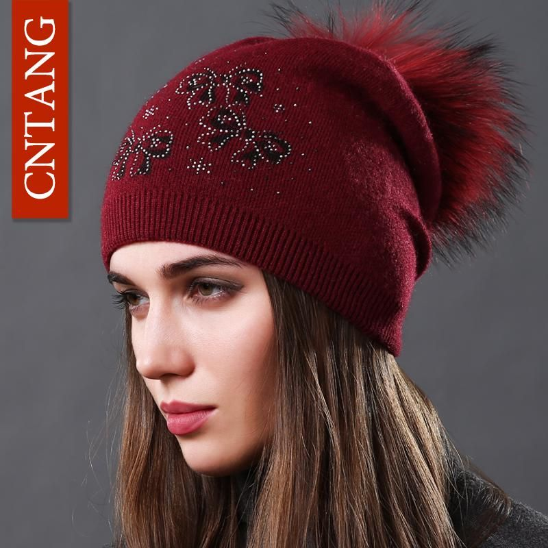 fa68d881194e8 CNTANG Real Natural Raccoon Fur Pompom Bow Hats Autumn Winter Warm Knitted  Wool Caps For Women Fashion Female Fleece Hat Beanies.