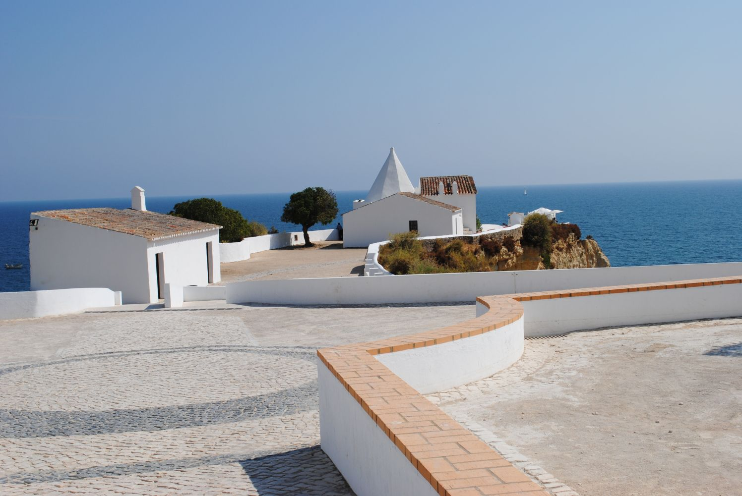 We got married on a clifftop called Senhora da Rocha, in Portugal. It's one of the most beautiful locations we have ever visited and has this lovely chapel to admire too. It was a good price …