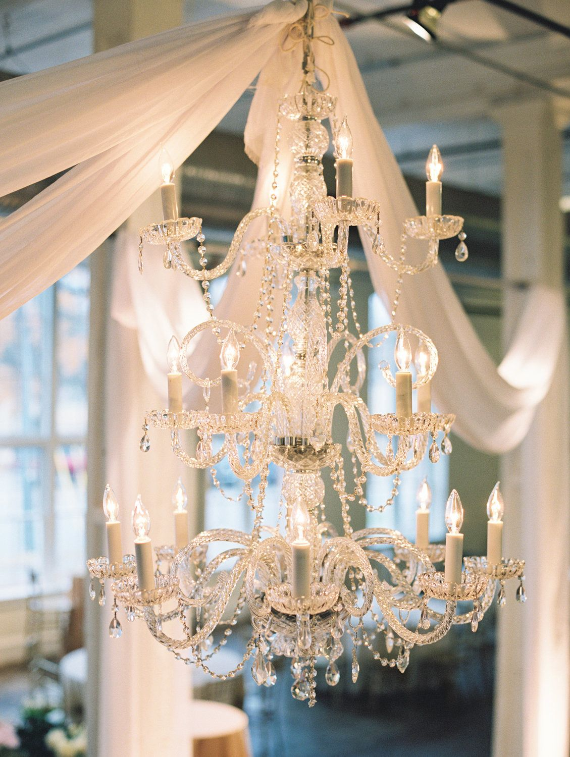 #lighting, #draping, #chandelier Photography: Landon Jacob Productions - landonjacob.com Read More: http://www.stylemepretty.com/2014/10/16/sparkling-sequin-winter-wedding-in-columbia-sc/