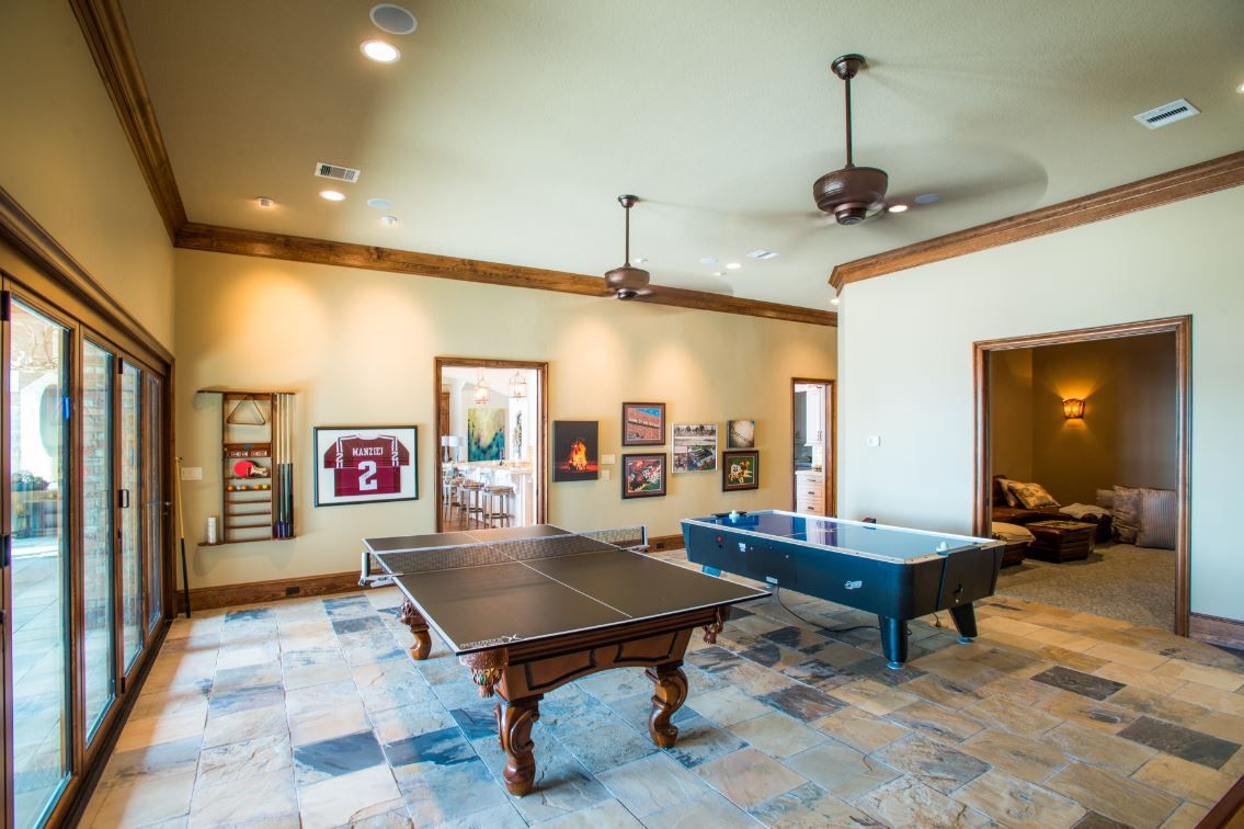 Some games are timeless for a reason. Game room open to TV room | Architect, New homes ...